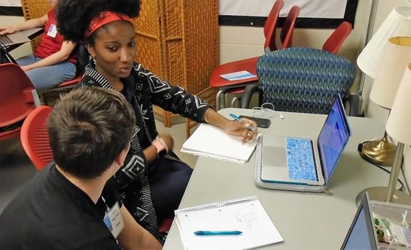 Tutor working with student.