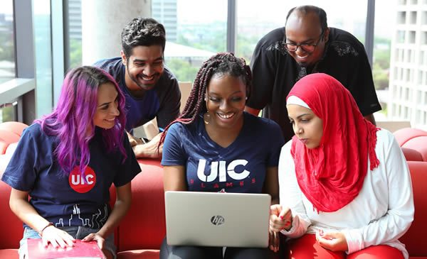 Students looking at laptop.